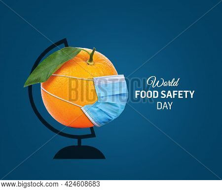 World Food Safety Day Concept. World Food Safety Day With Corona Concept. Orange With A Face Mask. 7