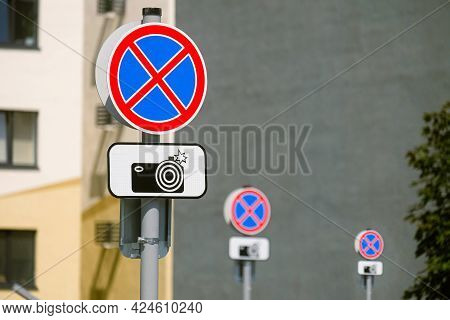 Many Road Signs Prohibiting Stopping And Parking. Warning Plate About The Photographic Recording Of