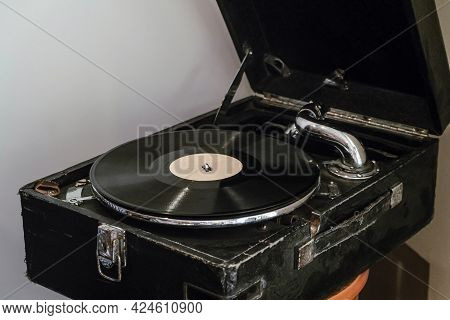 Vintage Classic Record Player In The Form Of A Black Suitcase. Vinyl Record.