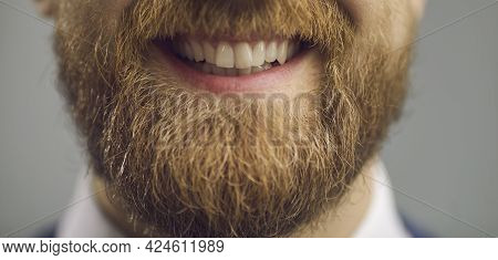 Young Bearded Hipster Man Giving Smile Showing Teeth To Camera Closeup Shot