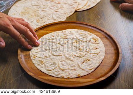Flatbread Pita On A Round Wooden Cutting Board. Bakery. Flat Bread