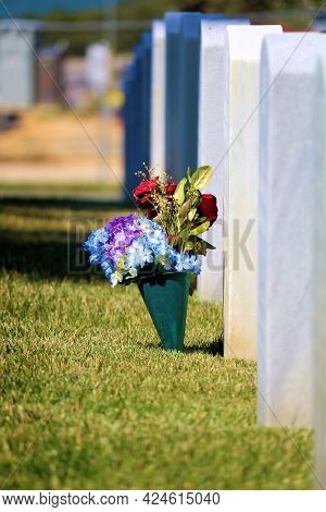 June 7, 2021 In San Francisco, Ca:  Freshly Placed Flowers Besides A Headstone At A Row Of Headstone