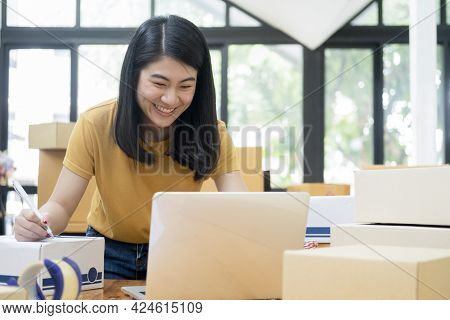 Young Business Startup Online Seller Owner Using Computer For Checking The Customer Orders From Emai