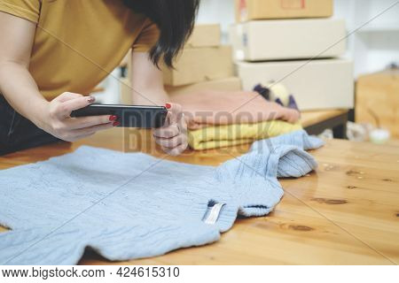 Online Seller Owner Take A Photo Of Product For Upload To Website Online Shop. Online Selling , Onli