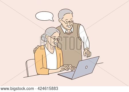 Senior People And Technologies Concept. Positive Mature Elderly Couple Using Laptop Together Learnin