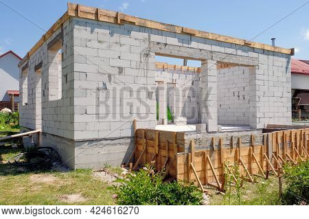Building A House From A Foam Block Or Aerated Block. Construction Site. Construction And Renovation