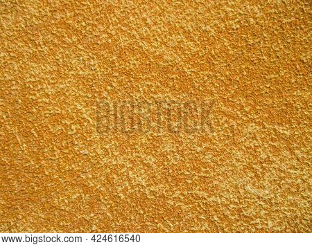 Gold Background With Splashes Of Yellow. The Texture Is Rough Rough. Copy Space.