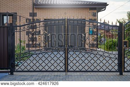 Transparent Metal Forged Gates In Front Of The Entrance To The Garage