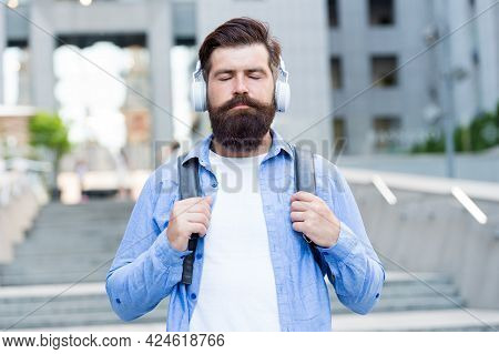 Experience Relaxing Mood With Zen Sound. Bearded Man Listen To Music With Closed Eyes. Meditation So