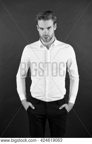 Wear It Simple. White Shirt And Black Pants. Serious Man Dark Background. Fashion Look Of Handsome G