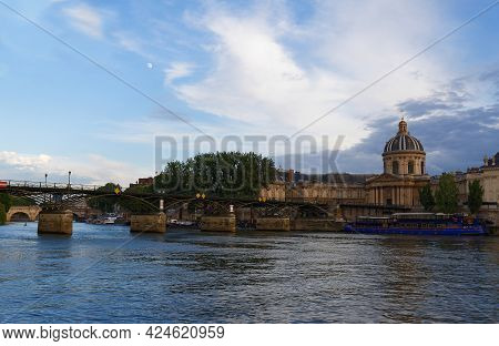 The Seine River, French Academy And Arts Bridge , Paris, France.