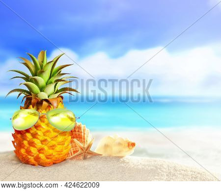 Pineapple With Sunglasses In The Beach. Summer Beach Concept.