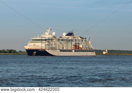 Stade, Germany - June15, 2021: Expedition cruise ship HANSEATIC NATURE on Elbe river on a voyage to Norway