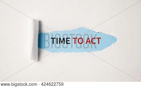 Torn White Paper Revealing The Words Time To Act On Blue Background