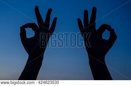 Two Man Hand Shows Sign Okay. Sign Ok Silhouette. Sign Okay.