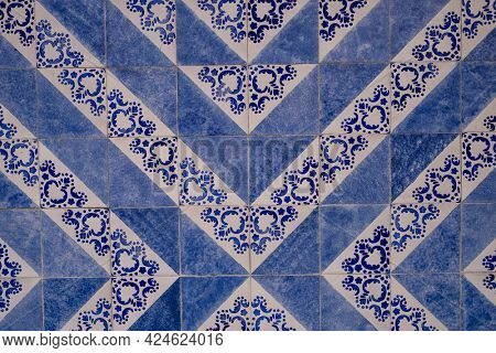 Traditional old tiles on the street Portuguese painted tin-glazed, azulejos ceramic tilework. Porto, Portugal.