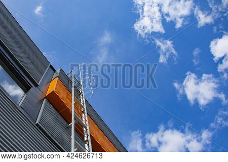 Stairway To Heaven. Metal Staircase On The Building Against The Background Of The Sky And Clouds.