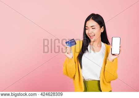 Happy Asian Portrait Beautiful Cute Young Woman Excited Smiling Hold Mobile Phone And Plastic Debit