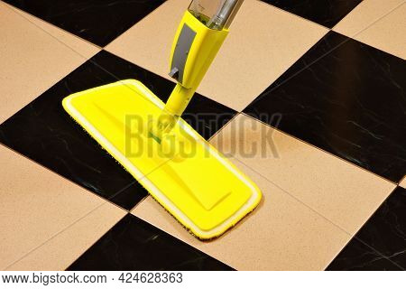 Cleaning Of The Tile Floor Surface From Contamination With A Cleaning Mop. Sanitary Restoration Of C