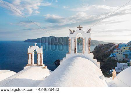 White Church Belfries And  Volcano Caldera With Sea Landscape, Beautiful Details Of Santorini Island