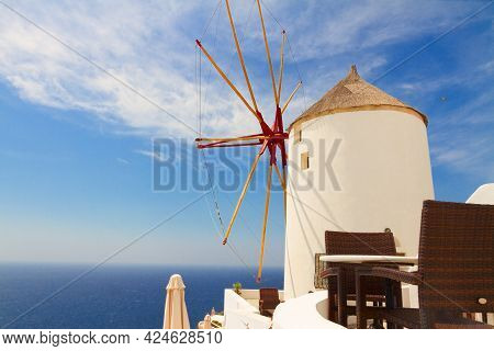 Windmill Of Oia At Sunny Day  With Blue Sea And Sky Close Up, Santorini