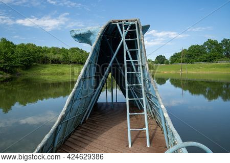 Catoosa, Oklahoma - May 5, 2021: The Famous Road Side Attraction Blue Whale Of Catoosa Along Histori