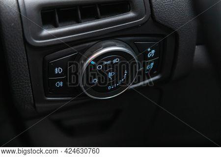 Novosibirsk, Russia - June 22, 2021: Ford Focus, Close Up Shot Of Car Headlight Control Panel