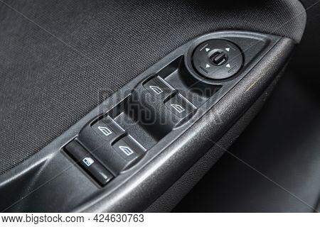 Novosibirsk, Russia - June 22, 2021: Ford Focus, Closeup Of A Door Control Panel In A New Car. Arm R