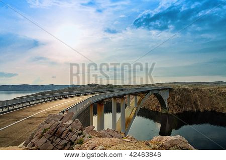 Bridge To The Pag Island With Sun And Clouds, Croatia