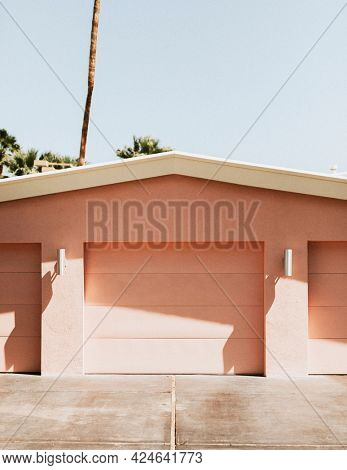 Driveway of a pink garage