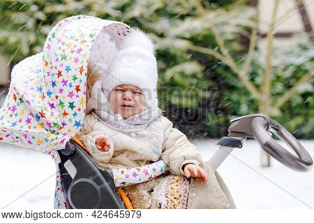 Sad Crying Little Baby Girl Sitting In The Pram Or Stroller On Winter Day. Unhappy Upset Tired And E