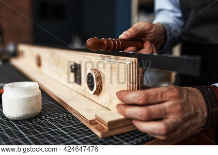 A Worker In A Leather Workshop Makes Belts, A Plan Of A Workers Hands While Making A Handmade Leathe