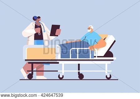 Nurse Taking Care Of Sick Senior Man Patient Lying In Hospital Bed Care Service Concept