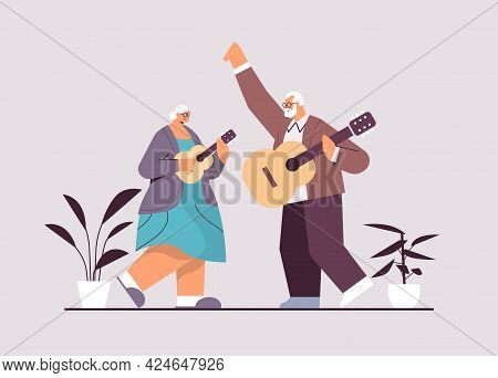 Senior Couple Playing Guitar Grandparents Having Fun Active Old Age Concept