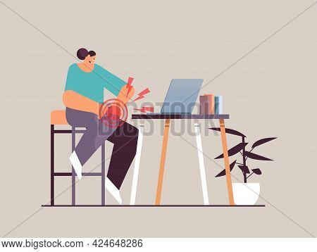 Businesswoman At Workplace Suffering From Knee Pain Inflammation Of Muscles Concept