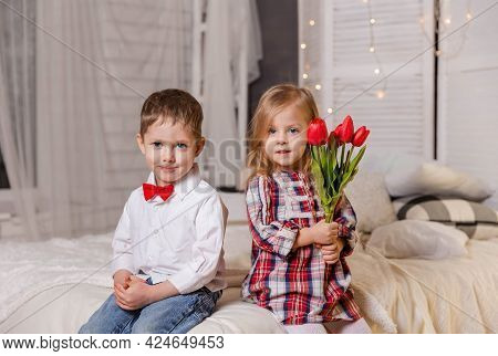 Happy Children In Casual Clothes. Cute Stylish Children. True Love. Portrait Of Smiling Boy And Cute