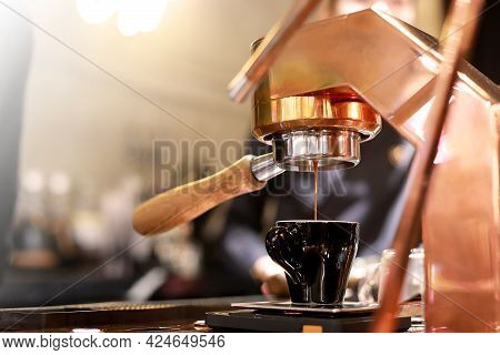 Barista Making Hot Espresso Coffee With The Coffee Machine In The Coffee Shop Or Cafe, Foods And Dri