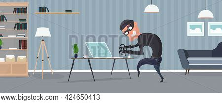 Thief In The House. A Robber Steals Data From A Laptop. Security Concept. Thief Man Steals An Apartm