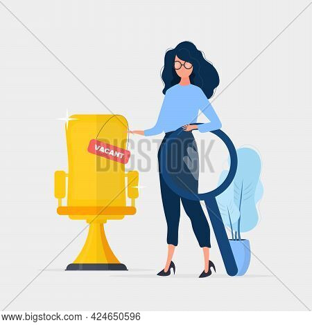 Girl Shows On A Vacant Place. Gold Cup In The Shape Of An Office Chair. The Concept Of Open Work. Su