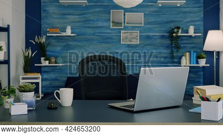 Empty Workspace Of Freelancer Worker With Laptop Computer On Desk And Cup Of Coffee. Interior Of Emp
