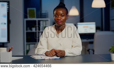 Pov Of African Freelancer Discussing Online With Colleague Sitting In Front Of Camera In Start-up Of