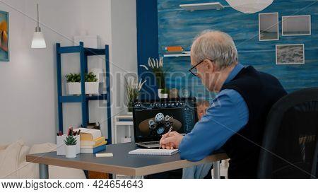 Senior Remote Man Architect Working On Modern Cad Program Analysing Gears Design. Industrial Old Eng