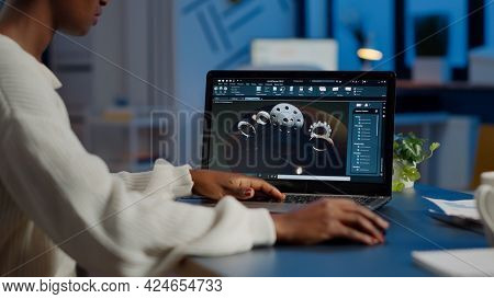 Tired African Designer Engineer Analyzing New Prototype Of 3d Model Of Industry Product, Working Ove