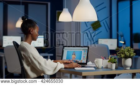 Dark Skin Freelancer Retoucher Woman Working Overtime On Laptop With Photo Editing Software. Profess