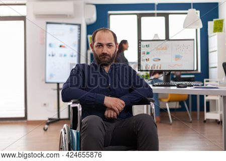 Sad Businessman Frustrated Of His Disabilities Looking At Camera Sitting Immobilized Paralysed In Wh