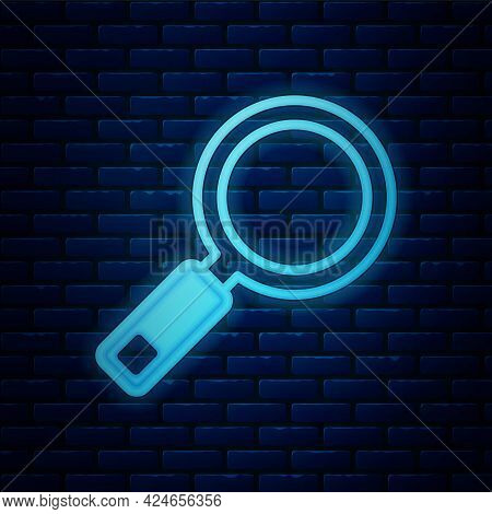 Glowing Neon Magnifying Glass Icon Isolated On Brick Wall Background. Search, Focus, Zoom, Business