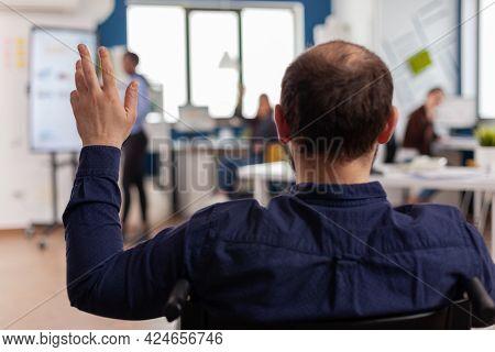 Independence Handicapped Businessman Entrepreneur Coming In Start Up Office Waving Sitting Immobiliz