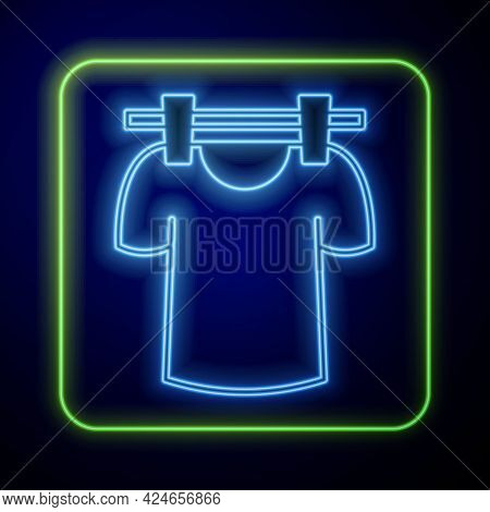 Glowing Neon Drying Clothes Icon Isolated On Blue Background. Clean Shirt. Wash Clothes On A Rope Wi