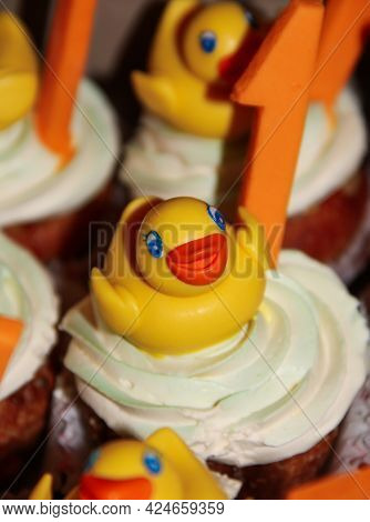 Festive Cupcakes With Mastic Duck Decoration And Number One
