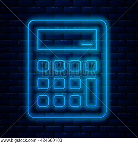Glowing Neon Line Calculator Icon Isolated On Brick Wall Background. Accounting Symbol. Business Cal
